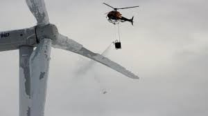 Viral Image of Helicopter De-Icing Texas Wind Turbine From 2016